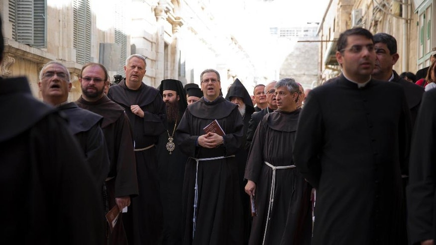 The new custodian of the Catholic Church's properties in the Holy Land Italian Franciscan priest Rev. Francesco Patton,centre, walks during a precession in Jerusalem's Old City, Monday, June 6, 2016. Patton replaced Pierbattista Pizzaballa in the ceremony on Monday. Several hundred people attended the festivities. (AP Photo/Ariel Schalit)