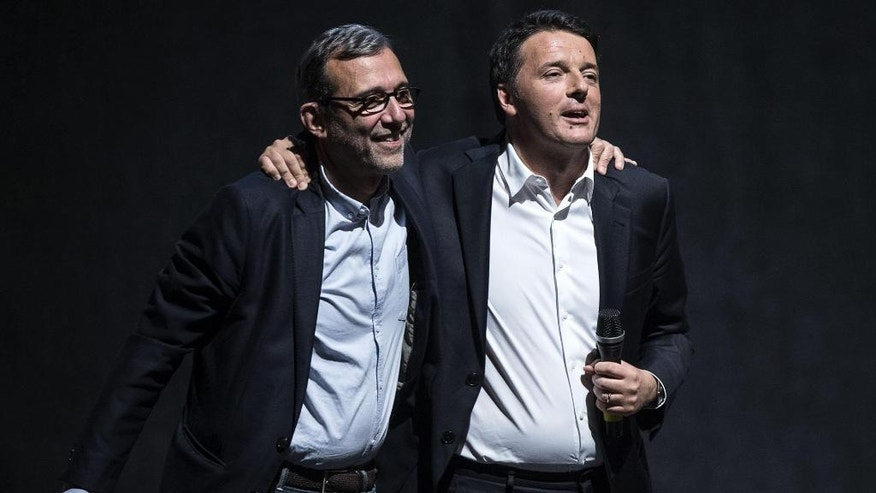 Democratic Party candidate for Rome's mayoral elections, Roberto Giachetti, left, is flanked by Italian Premier and Party Leader Matteo Renzi during a campaign rally in Rome, Wednesday, June 1, 2016. Virginia Raggi of the 5-Star Movement, an anti-establishment candidate in Rome, has comfortably clinched a runoff mayoral election slot, as Romans disgusted by corruption scandals and deteriorating city services largely turned away from traditional left and right parties which governed the Italian capital for decades. (Angelo Carconi/ANSA Via AP)