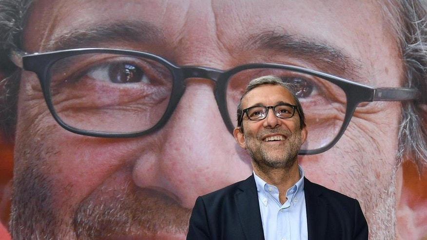 Democratic Party candidate for Rome's mayoral elections, Roberto Giachetti, smiles during a campaign rally in Rome, Friday, June 3, 2016. Virginia Raggi of the 5-Star Movement, an anti-establishment candidate in Rome, has comfortably clinched a runoff mayoral election slot, as Romans disgusted by corruption scandals and deteriorating city services largely turned away from traditional left and right parties which governed the Italian capital for decades. (Ettore Ferrari/ANSA Via AP)
