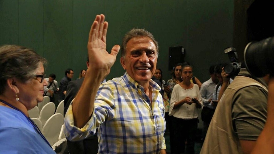Miguel Angel Yunes waves at supporters as he arrives to give a news conference in Veracruz, Mexico, Sunday, June 5, 2016. Mexico's ruling party appeared to have suffered a series of stinging defeats in the 12 governorships up for grabs in state elections, according to preliminary vote counts Monday. Hobbled by corruption scandals, violence and a weak economy, the ruling Institutional Revolutionary Party lost four states including Veracruz, a state of 8 million that is the third most-populous in the country. (AP Photo/Ilse Huesca)