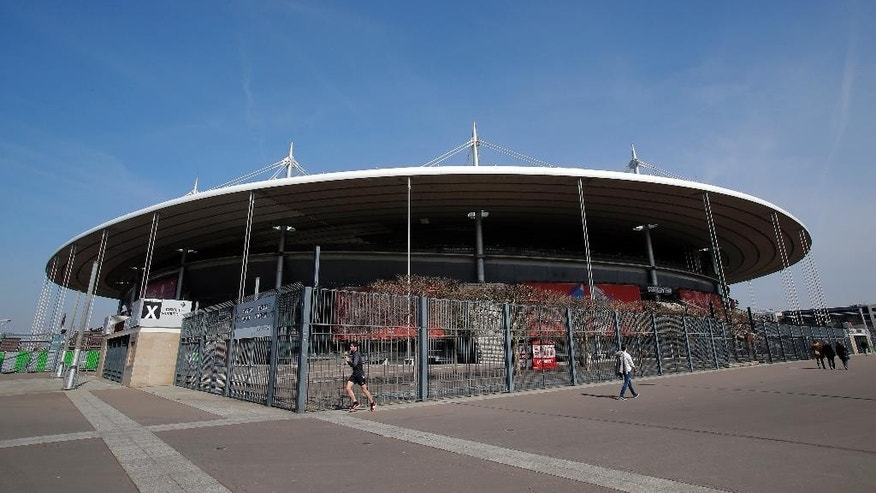 In this photo taken on Tuesday, March 15, 2016, The Stade de France Stadium is pictured in Saint Denis, north of Paris. The stadium is a venue for the Euro 2016 soccer tournament. (AP Photo/Christophe Ena)