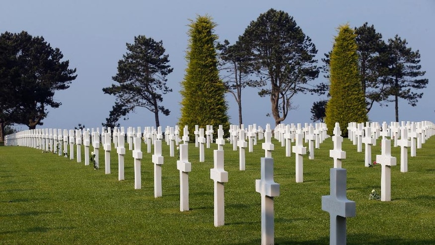 CORRECTS YEAR TO 2016- Tombs at the Colleville American military cemetery, in Colleville sur Mer, western France, Sunday June 5, 2016, on the eve of the 72nd anniversary of the D-Day landing. D-Day marked the start of a Europe invasion, as many thousands of Allied troops began landing on the beaches of Normandy in northern France in 1944 at the start of a major offensive against the Nazi German forces, an offensive which cost the lives of many thousands. (AP Photo/Francois Mori)