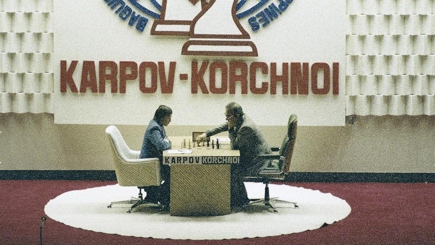 FILE - In this July 20, 1978 file photo, chess players Anatoly Karpov and Victor Korchnoi are seen during their second game in the Philippines. Chess grandmaster Victor Korchnoi, a prominent Soviet defector who saw his citizenship restored by Mikhail Gorbachev in the waning days of the USSR, has died on Monday, June 6, 2016. He was 85. The Russian chess federation says Korchnoi died in Switzerland, where he had lived for decades. (AP Photo/Neal Ulevich, file)