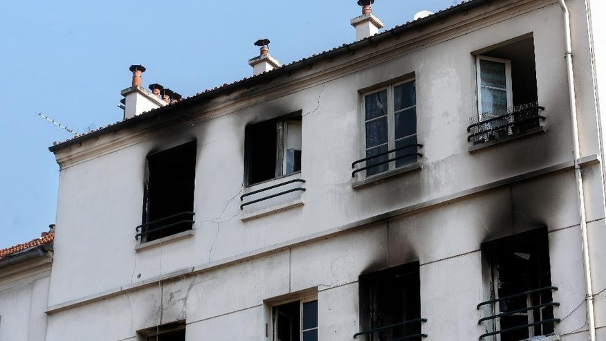A burned building is seen in Saint-Denis, north of Paris, Tuesday, June 7, 2016. A fire in an apartment building near France's national stadium left at least five people dead and 11 injured. (AP Photo/Thibault Camus)