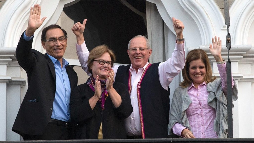 Flanked by his running mates Mercedes Araoz, right, and Martin Vizcarra, presidential candidate Pedro Pablo Kuczynski and his wife Nancy Lange, greet supporters and reporters gathered outside their home in Lima, Peru, Monday, June 6, 2016. Kuczynski had a razor-thin lead over his rival Keiko Fujimori, the daughter of jailed former strongman Alberto Fujimori, as Peruvians awaited results still trickling in from remote parts of the Andean nation. (AP Photo/Silvia Izquierdo)