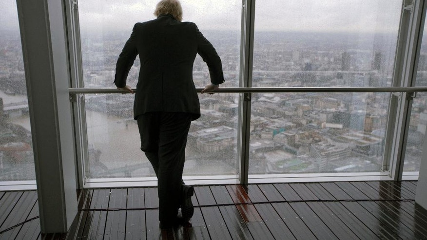 "FILE - In this file photo dated Friday, Feb. 1, 2013, London mayor Boris Johnson poses as he looks out over London, during an event to officially open the ""The View"" viewing platform at the 95-storey Shard skyscraper in London, Friday, Feb. 1, 2013.  From the international banks in the skyscrapers of Canary Wharf to the traditional home of Britain's financial industry in the City of London, bankers and money managers across the capital are watching the upcoming June 23 referendum on EU membership with trepidation.(AP Photo/Matt Dunham, FILE)"
