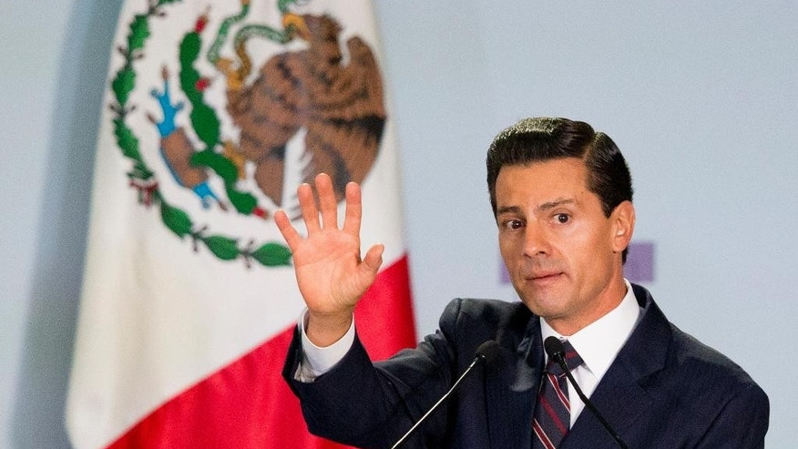 Mexican President Enrique Pena Nieto declares open the 8th National Forum for Security and Justice, after delivering his address in Mexico City, Tuesday, June 7, 2016. On the same day that Pena Nieto spoke at the forum, the international program Open Society Justice Initiative released a report saying the Mexican government has committed crimes against humanity in its war against drug cartels. (AP Photo/Rebecca Blackwell)