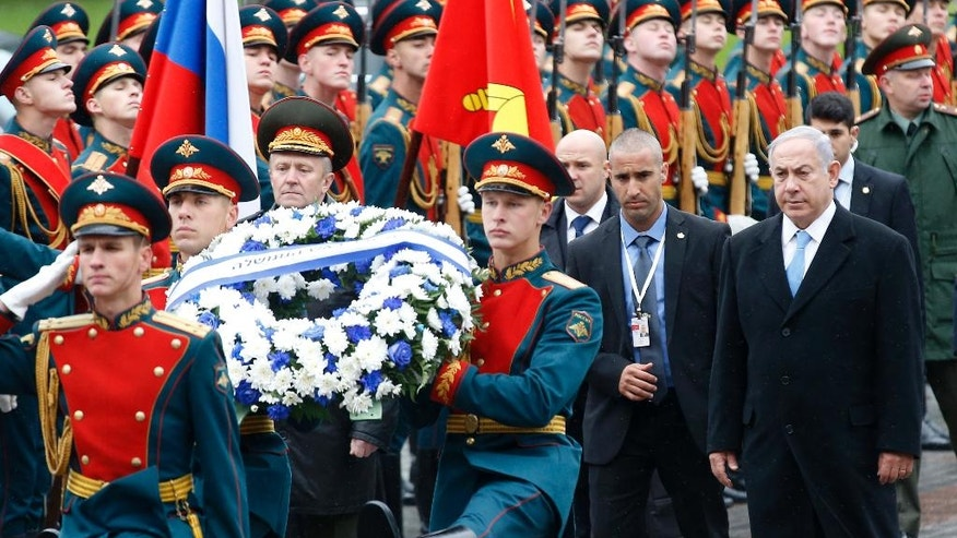 Israeli Prime Minister Benjamin Netanyahu, right, attends a wreath laying ceremony at the Tomb of Unknown Soldier near the Kremlin Wall in Moscow, Tuesday, June 7, 2016. Netanyahu is Russia on an official two-day visit. (Maxim Shipenkov/Pool photo via AP)
