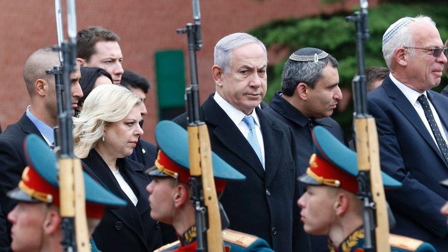 Israeli Prime Minister Benjamin Netanyahu, center, reviews an honor guard as he attends a wreath laying ceremony at the Tomb of Unknown Soldier near the Kremlin Wall in Moscow, Tuesday, June 7, 2016. Netanyahu is Russia on an official two-day visit. (Maxim Shipenkov/Pool photo via AP)