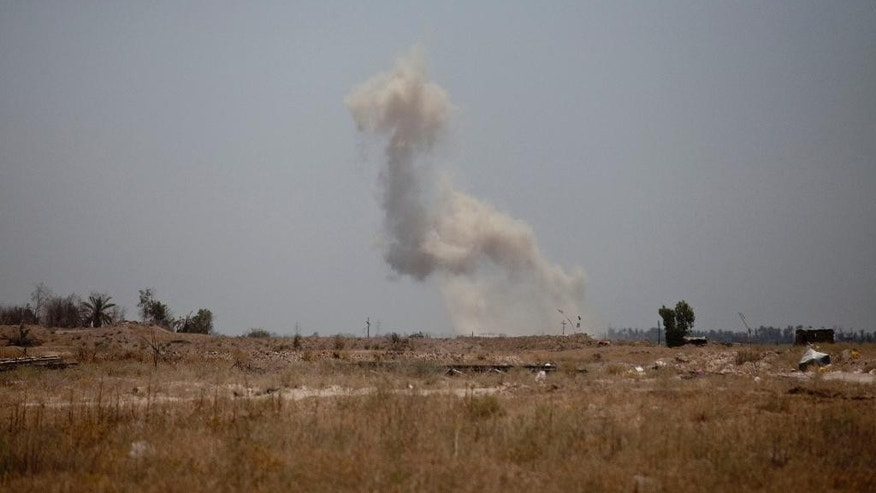 Smoke rises from an Islamic State group position near the front line where Iraqi counterterrorism forces are battling to oust the militants from the city of Fallujah, Iraq, Tuesday, June 7, 2016. (AP Photo/Maya Alleruzzo)