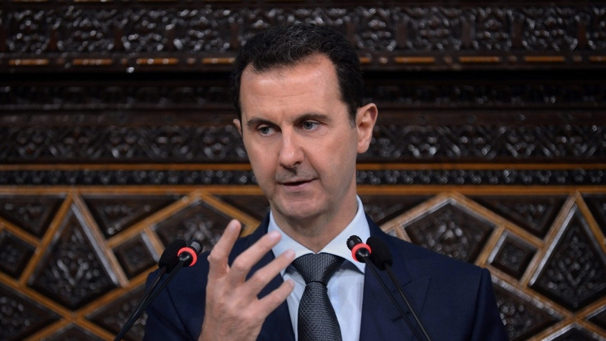 June 7, 2016: In this photo released by the Syrian official news agency SANA, Syrian President Bashar Assad, addresses a speech to the newly-elected parliament at the parliament building, in Damascus, Syria.