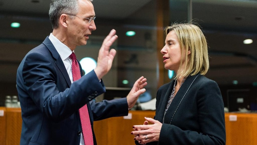 FILE - In this May 18, 2015 file photo, NATO Secretary General Jens Stoltenberg, left, speaks with European Union High Representative Federica Mogherini during a meeting at the European Council building in Brussels. The EU's Federica Mogherini said the official calendar for the summer of 2016 provides good synergy for forging a better working relationship between NATO and the EU. (AP Photo/Geert Vanden Wijngaert, File)