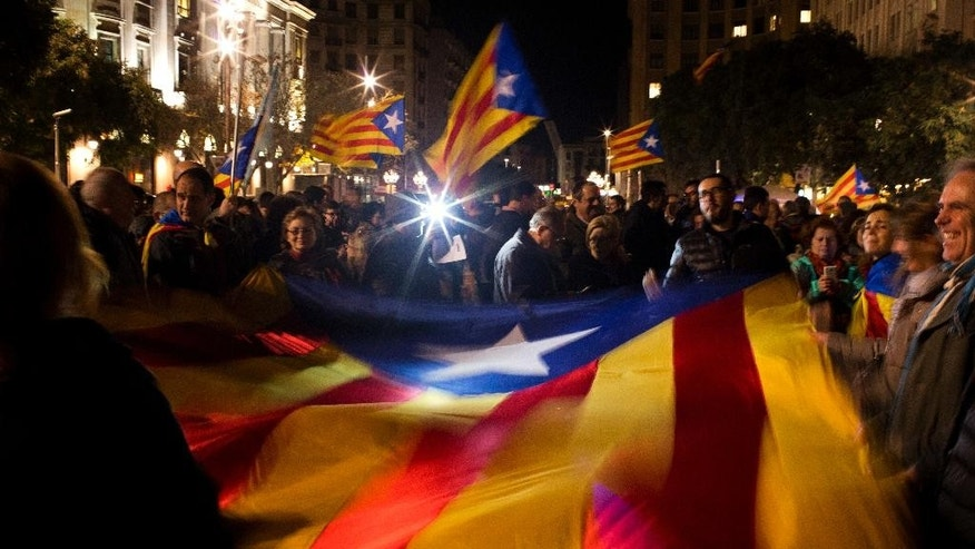 "FILE - In this Thursday, Jan. 7, 2016 file photo, pro independent demonstrators wave ""estelada"" or pro independence flags during a rally organized by the Catalan National Assembly (ANC), calling pro-independents parties to reach an agreement to form a Government and avoid a new regional elections, in Barcelona, Spain. The leader of Spain's Catalonia region, Carles Puigdemont, announced Wednesday, June 8, 2016 that his pro-independence government will face a confidence vote in September after a party backing his coalition decided not to support the regional spending plan. The leftist party known as CUP says the regional budget doesn't do enough to support social and pro-secession programs.(AP Photo/Emilio Morenatti, file)"
