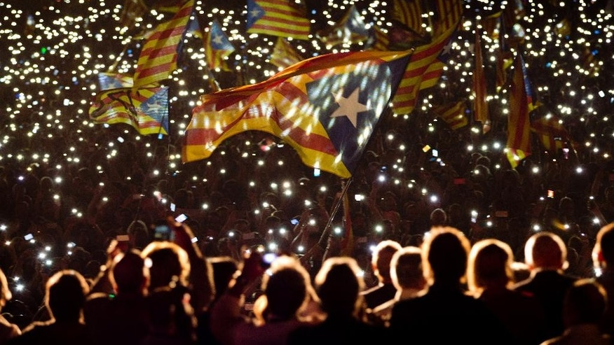 "FILE - In this Friday, Sept. 25, 2015 file photo, pro independence supporters wave ""estelada"" or pro independence flags during a rally of ""Junts pel Si"" or ""Together for YES"" in Barcelona, Spain. The leader of Spain's Catalonia region, Carles Puigdemont, announced Wednesday, June 8, 2016 that his pro-independence government will face a confidence vote in September after a party backing his coalition decided not to support the regional spending plan. The leftist party known as CUP says the regional budget doesn't do enough to support social and pro-secession programs. (AP Photo/Emilio Morenatti, file)"