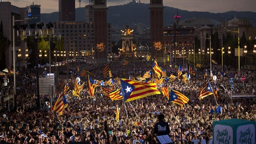 "FILE - In this Friday, Sept. 25, 2015 file photo, pro independence supporters wave ""estelada"" or pro independence flags during a rally of ""Junts pel Si"" or ""Together for YES"" in Barcelona, Spain. The leader of Spain's Catalonia region, Carles Puigdemont, announced Wednesday, June 8, 2016 that his pro-independence government will face a confidence vote in September after a party backing his coalition decided not to support the regional spending plan. The leftist party known as CUP says the regional budget doesn't do enough to support social and pro-secession programs.(AP Photo/Emilio Morenatti, file)"