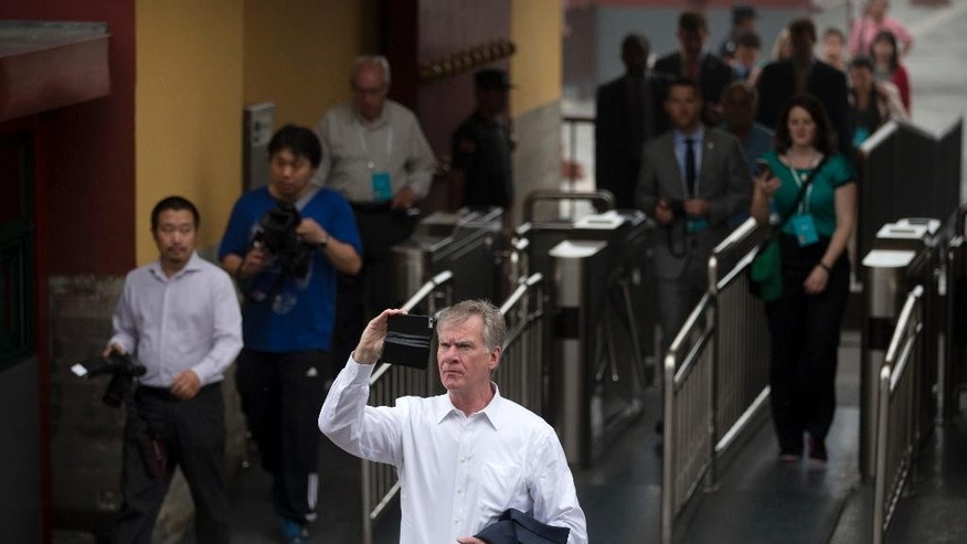 St. Paul, Minn., Mayor Chris Coleman takes a photo at the Temple of Heaven in Beijing, Wednesday, June 8, 2016. Coleman is part of a delegation of leaders from American cities participating in the U.S.-China Climate-Smart/Low-Carbon Cities Summit. (AP Photo/Mark Schiefelbein)