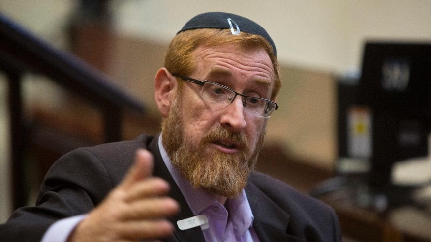 In this Thursday, June 2, 2016 photo, Knesset member Yehuda Glick, speaks during an interview with The Associated Press at the Knesset, Israel's parliament, in Jerusalem. For years, Glick has pushed for greater Jewish access to Jerusalem's most sensitive holy site -- promoting an ideology that has unnerved Palestinians and made him the target of an assassination attempt. Now, as a new member of Israel's parliament, Glick is vowing to use his office to press his cause, bringing his explosive campaign to the nation's corridors of power. (AP Photo/Sebastian Scheiner)