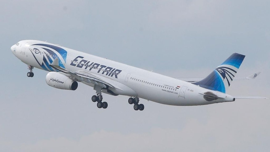 FILE - In this May 19, 2016 file photo, an EgyptAir Airbus A330-300 takes off for Cairo from Charles de Gaulle Airport outside of Paris. Egyptians officials say a bomb threat has forced an EgyptAir airliner en route to Beijing from Cairo to make an emergency landing in Uzbekistan, where the aircraft is being searched. (AP Photo/Christophe Ena, File)