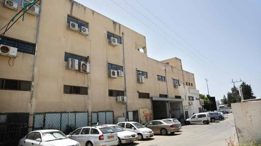 Police say this building served as the headquarters of an international scam operation that duped global companies out of more than $10 million, in the coastal city of Netanya, Israel.