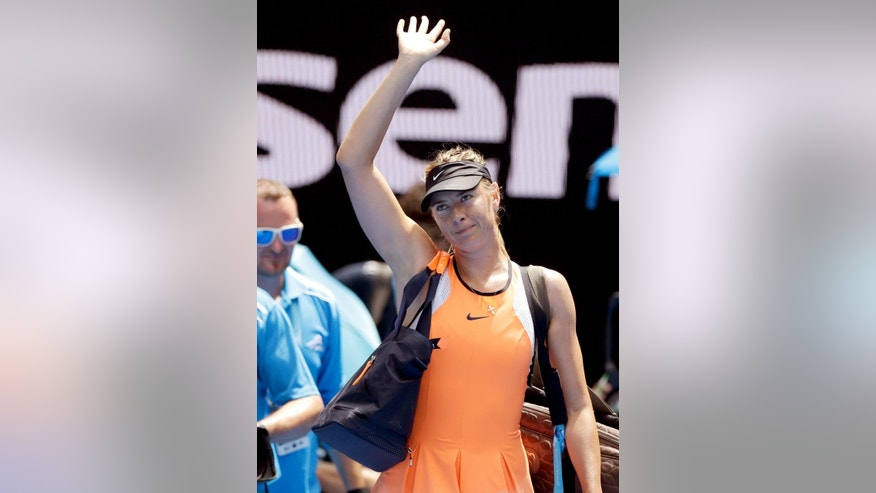 FILE  - In this Tuesday, Jan. 26, 2016 file photo, Maria Sharapova of Russia waves as she leaves Rod Laver Arena following her quarterfinal loss to Serena Williams of the United States at the Australian Open tennis championships in Melbourne, Australia. Sharapova has been suspended for two years by the International Tennis Federation for testing positive for meldonium at the Australian Open. The ruling, announced Wednesday, June 8, 2016 can be appealed to the Court of Arbitration for Sport. (AP Photo/Aaron Favila, File)