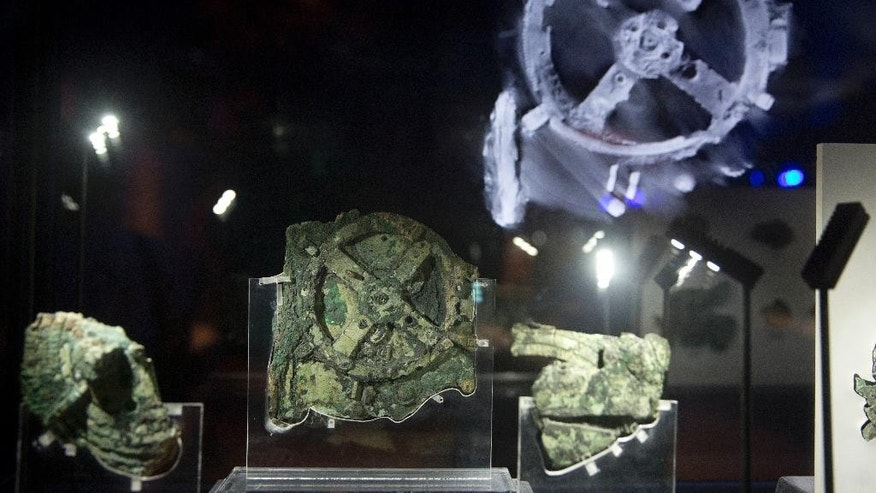 Fragments of the 2,100-year-old Antikythera Mechanism, believed to be the earliest surviving mechanical computing device, is displayed at the National Archaeological Museum, in Athens, Thursday, June 9 , 2016. An international team of scientists says a decade's painstaking work on the corroded fragments found in an ancient Greek shipwreck has deciphered roughly 500 words of text that explained the workings of the complex machine, described as the world;s first mechanical computer. (AP Photo/Petros Giannakouris)