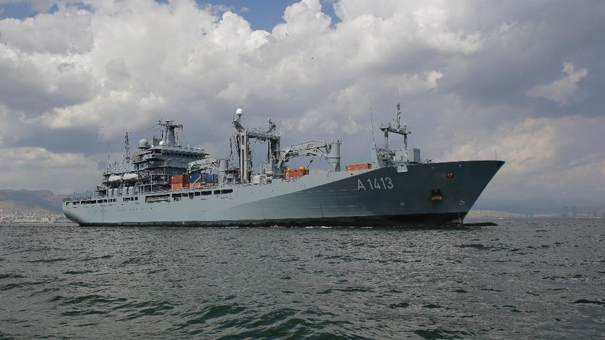 FILE - In this Thursday, May 26, 2016 file photo, The NATO German warship FGS Bonn departs from the harbor of the city of Izmir, Turkey. The FGS Bonn is part of the NATO flotilla patrolling the Aegean Sea in an effort to curb migrant activity between Turkey and Greece. (AP Photo/Markus Schreiber, File)