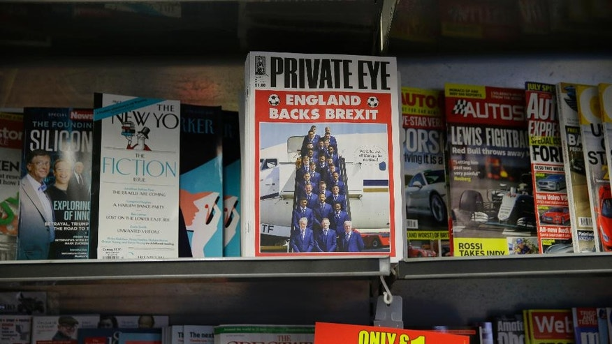 A copy of the satirical Private Eye magazine is displayed for sale with a Brexit themed cover in a store in London, Wednesday, June 8, 2016. Mary Poppins supports the EU, but Basil Fawlty is backing Brexit. The practically perfect nanny and the bad-tempered hotelier may be fictional, but they have still been dragged in to Britain's EU membership debate _ providing a welcome dose of levity for referendum-weary voters. With two weeks until Britain decides whether to walk away from the 28-nation bloc, electors are enduring a long and bitter campaign that has seen rival politicians make predictions of doom if voters make the wrong choice. (AP Photo/Matt Dunham)