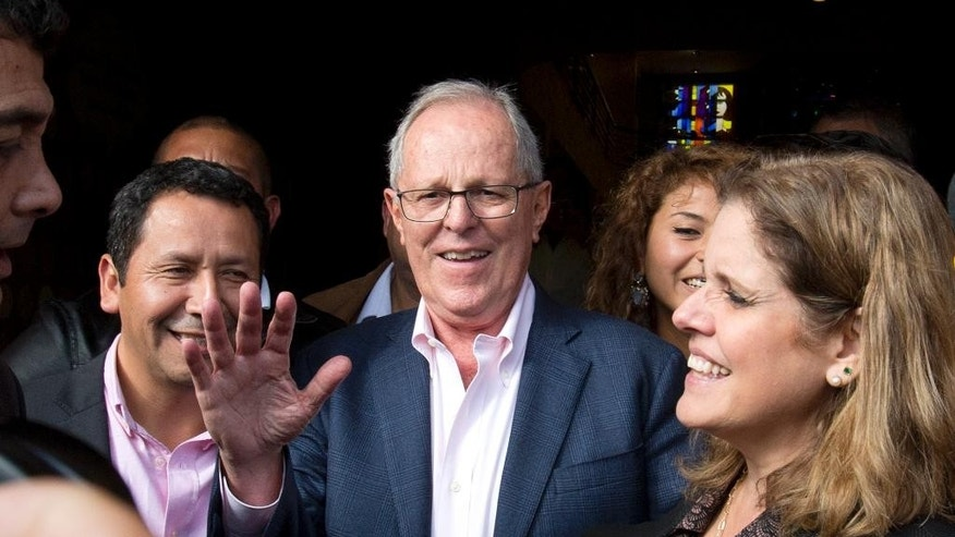Presidential candidate Pedro Pablo Kuczynski, center, and one of his two running mates Mercedes Araoz, right, leave a restaurant in Lima, Peru, Tuesday, June 7, 2016. Kuczynski has a razor-thin lead over his rival Keiko Fujimori, the daughter of jailed former strongman Alberto Fujimori, as Peruvians await results still trickling in from remote parts of the Andean nation. (AP Photo/Silvia Izquierdo)