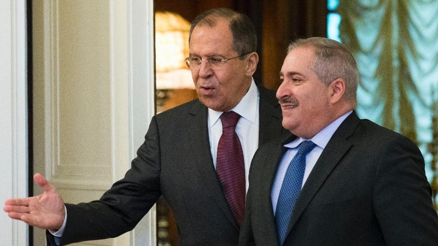 Russian Foreign Minister Sergey Lavrov, left, welcomes Jordanian Foreign Minister Nasser Judeh before their talks in Moscow, Russia, Thursday, June 9, 2016. The talks focused on bilateral ties and the situation in Syria. (AP Photo/Alexander Zemlianichenko)