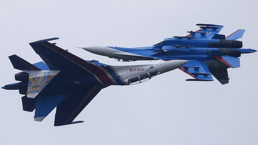 August 1, 2015: Sukhoi Su-27 fighters of the Russian Knights aerobatic display team perform during a demonstration flight at an opening ceremony of the International Army Games-2015 in Alabino, outside Moscow, Russia.