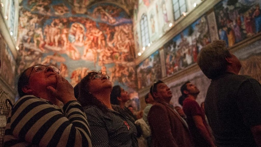 Visitors stand inside a replica of the Sistine Chapel in Mexico City, Thursday, June 9, 2016. The Vatican granted permission for the construction of the life-size model that required millions of photographs to be made of the actual building. (AP Photo/Nick Wagner)