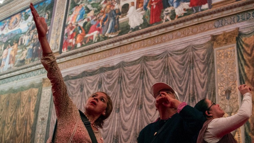 Visitors look at a replica of the Sistine Chapel in Mexico City, Thursday, June 9, 2016. The Vatican granted permission for the construction of the life-size model that required millions of photographs to be made of the actual building. (AP Photo/Nick Wagner)
