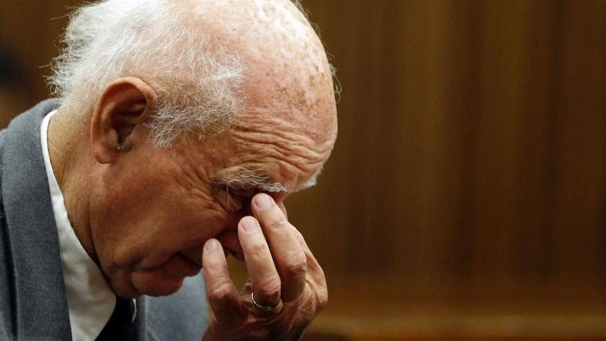 FILE - In this May 18 2015 file photo retired tennis player Bob Hewitt sits in the dock during his sentencing at the high court in Pretoria, South Africa. South Africa's Supreme Court on Thursday June 9, 2016 rejected an appeal by Hewitt, ruling that he must serve six years in jail after being convicted of rape and sexual assault of young girls he coached decades ago.(AP Photo/Themba Hadebe)