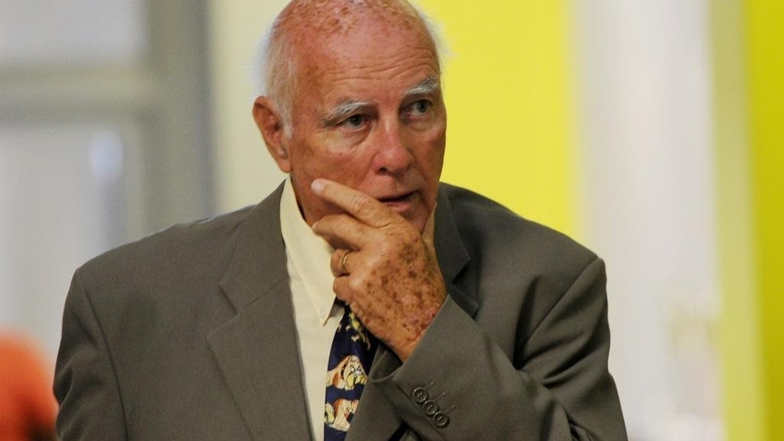 FILE - In this Feb. 9, 2015, file photo, former grand slam tennis doubles champion Bob Hewitt is shown outside a Johannesburg, South Africa court. South Africa's Supreme Court on Thursday June 9, 2016 rejected an appeal by Hewitt, ruling that he must serve six years in jail after being convicted of rape and sexual assault of young girls he coached decades ago. (AP Photo/File)