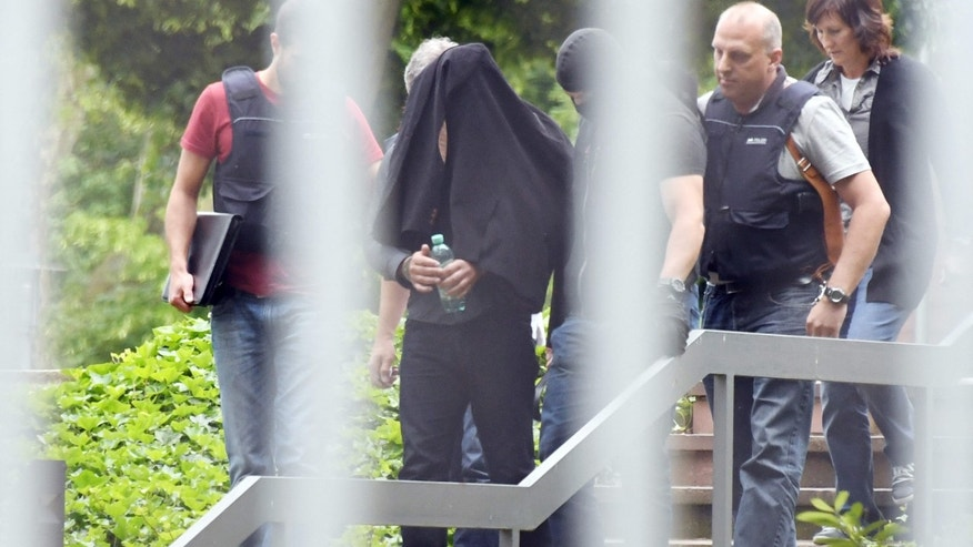 June 2, 2016: An alleged terror suspect is led by police at the Federal court in Karlsruhe, Germany.