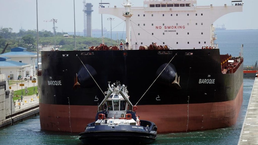 A Malta flagged cargo ship named Baroque navigates the Agua Clara locks as the first test of the newly expanded Panama Canal, in Agua Clara, Panama, Thursday, June 9, 2016. The canal's expansion project will be inaugurated on June 26. (AP Photo/Arnulfo Franco)
