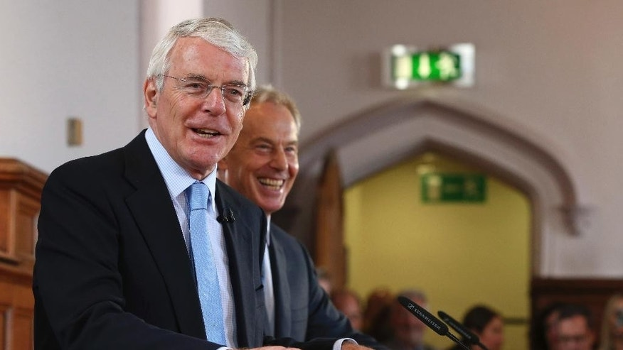 Former British prime ministers Sir John Major, left, and Tony Blair share a platform for the Remain campaign at the University of Ulster in Londonderry. Northern Ireland, Thursday June 9, 2016.  Britain's referendum on EU membership will take place on Thursday June 23. (Brian Lawless/PA via AP) UNITED KINGDOM OUT