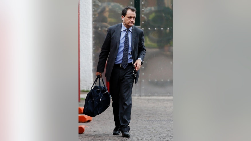 Lawyer Michele Calantropo leaves the Rebibbia penitentiary in Rome, Friday, June 10, 2016. The Eritrean man extradited to Italy under great fanfare as an alleged kingpin of a migrant smuggling ring told authorities on Friday that his arrest in Sudan was a case of mistaken identity, his lawyer, said. ''It is clear for him he is not the man who is smuggling or trafficking humans,'' Michele Calantropo said outside the Rome prison where the suspect was questioned by prosecutors from Sicily leading Italy's anti-smuggling investigations in the presence of a judge. (AP Photo/Fabio Frustaci)