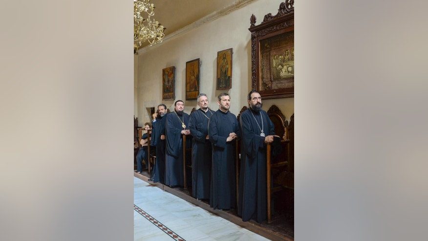In this Thursday, June 9, 2016, photo released by Holy and Great Council, Orthodox clergy attend a service at a chapel of a Monastery in Crete island, Greece.  The Bulgarian Orthodox church confirm Friday June 10, it will withdraw from a meeting later this month for Orthodox leaders.  The gathering of 14 independent Orthodox churches planned for later this month on the Greek island of Crete, is aimed at promoting unity among the world's 300 million Orthodox Christians, and the meeting will go ahead even if Bulgaria remain absent.  ( Holy and Great Council via AP)