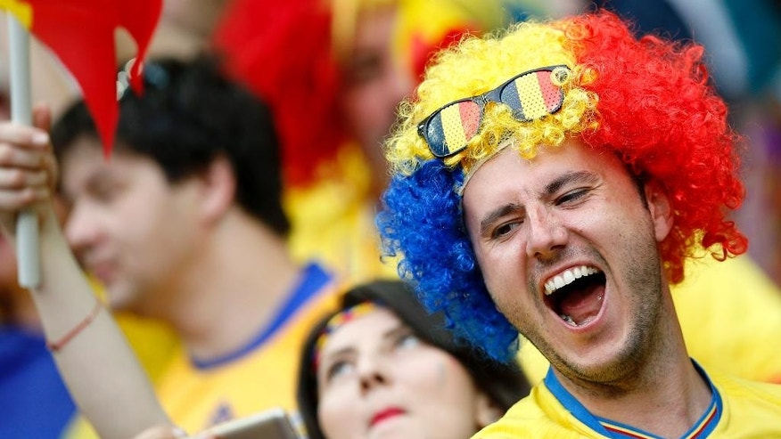 A Romanian fan cheers prior to the Euro 2016 Group A soccer match between France and Romania, at the Stade de France, in Saint-Denis, north of Paris, Friday, June 10, 2016. (AP Photo/Christophe Ena)