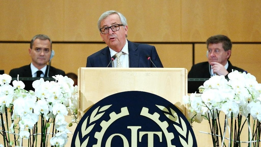 European Commission President Jean-Claude Juncker addresses his statement during the annual International Labour Conference of the International Labor Organization, ILO, at the European headquarters of the United Nations in Geneva, Switzerland, Thursday, June 9, 2016. (Magali Girardin/Keystone via AP)