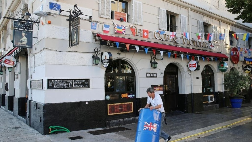 A member of staff cleans up at The Queen Victoria pub where police dispersed England football fans after a  clash with locals in the Old Port district of Marseille ahead of the first game in Euro 2016 Friday June 10, 2016.  Marseille is hosting a European Championship soccer match between England and Russia on Saturday. (Niall Carson/PA via AP) UNITED KINGDOM OUT
