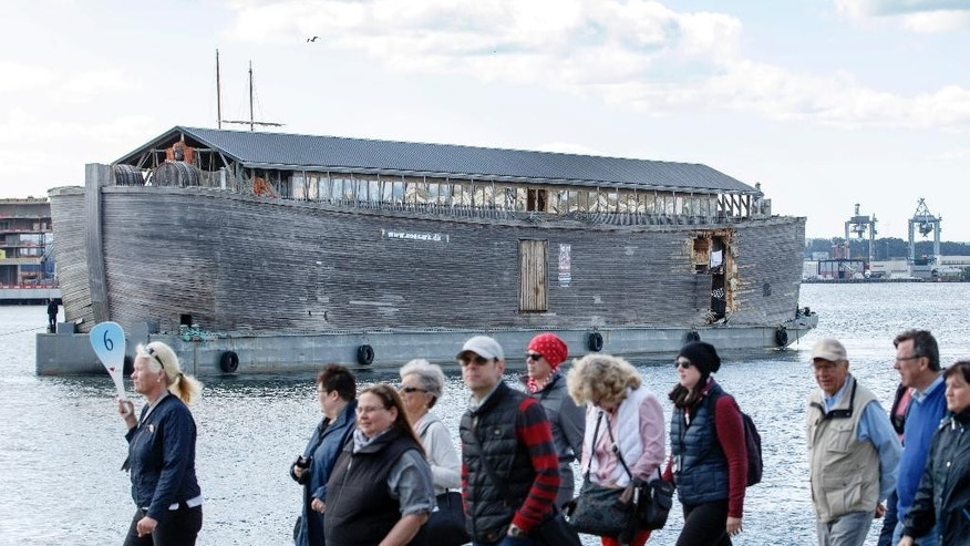 People walk past the damaged wooden exhibition ship built as a representation of Noah's Ark after it crashed into a moored Coast Guard vessel in Oslo harbour, Friday June 10, 2016. (Gorm Kallestad, NTB Scanpix) NORWAY OUT