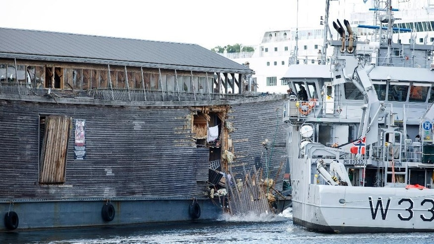 The damage of the hull of a wooden exhibition ship built as a representation of Noah's Ark after it crashed into a moored Coast Guard vessel in Oslo harbour, Friday June 10, 2016. (Hkon Mosvold Larsen, NTB Scanpix) NORWAY OUT