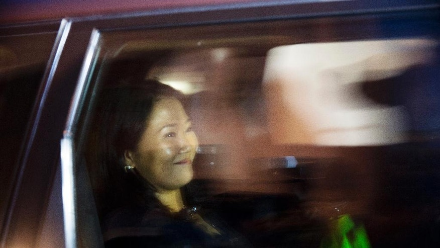 Presidential candidate Keiko Fujimori smiles as she is driven from a local campaign house, in Lima, Peru, Thursday, June 9, 2016. Former World Bank economist Pedro Pablo Kuczynski won the majority of votes in Peru's closest presidential contest in five decades, election officials announced Thursday, even as his rival Fujimori had yet to concede defeat. (AP Photo/Rodrigo Abd)