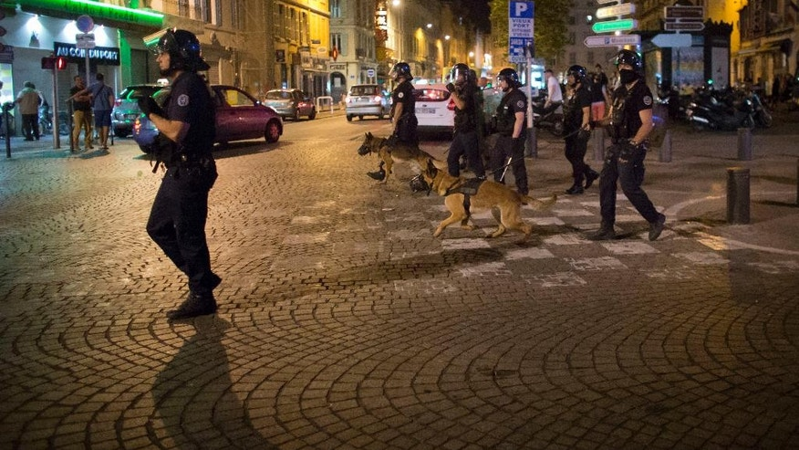 Police patrols on a street following scuffles in Marseille, France, early Friday, June 10, 2016. Trouble flared outside an Irish pub in the Old Port of the southern city just before midnight Thursday, apparently between English fans drinking there and some local people. Marseille is hosting a European Championship soccer match between England and Russia on Saturday. (AP Photo/Darko Bandic)
