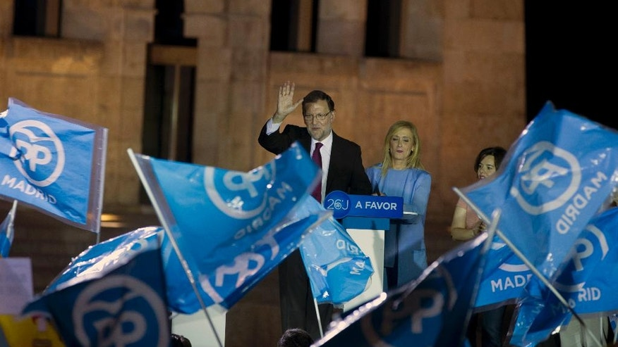 Spain's acting Prime Minister Mariano Rajoy waves during a rally before officially opening the General Election campaign, in front of the ancient Egyptian Temple of Debod in Madrid, Spain, Thursday, June 9, 2016. Spain's political parties are set to launch two-week campaigns leading up to a June 26, 2016 election aimed at breaking six months of political paralysis after a December election shattered the nation's two traditional two-party system and politicians failed to negotiate a governing coalition. (AP Photo/Paul White)