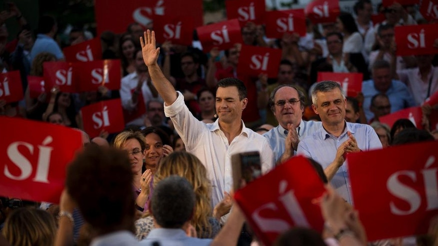 Spain's Socialist party leader Pedro Sanchez, centre, gestures to supporters during an election rally to officially open the General Election campaign in Madrid, Thursday, June 9, 2016. Spain's political parties are set to launch two-week campaigns leading up to a June 26 election aimed at breaking six months of political paralysis after a December election failed to negotiate a governing coalition. (AP Photo/Francisco Seco)
