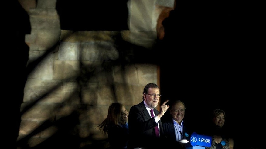 Spain's acting Prime Minister Mariano Rajoy makes a speech during a rally, before officially opening the General Election campaign in front of the ancient Egyptian Temple of Debod in Madrid, Spain, Thursday, June 9, 2016. Spain's political parties are set to launch two-week campaigns leading up to a June 26, 2016 election aimed at breaking six months of political paralysis after a December election shattered the nation's two traditional two-party system and politicians failed to negotiate a governing coalition. (AP Photo/Paul White)