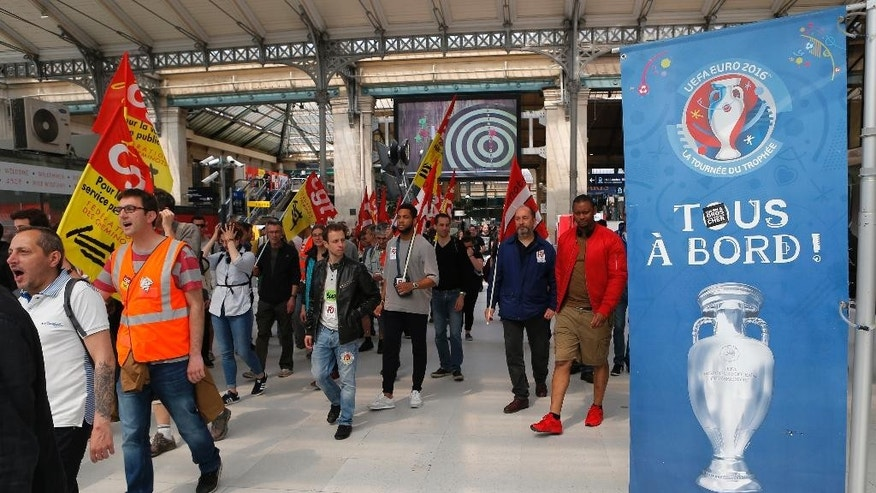 French railway workers and Labor unions members attend a demonstration against the French government and labor law reforms at Gare Du Nord Station in Paris France, Wednesday June 8, 2016. Workers of France's national rail service demonstrate as part of months of protests over changes to labor protections. (AP Photo/Francois Mori)